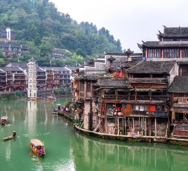 Folk houses along the river in the ancient city of Phoenix, Huna