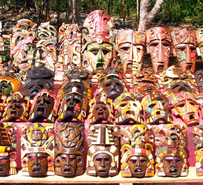 Chichen itza Mayan handcrafted wooden masks in Yucatan Mexico